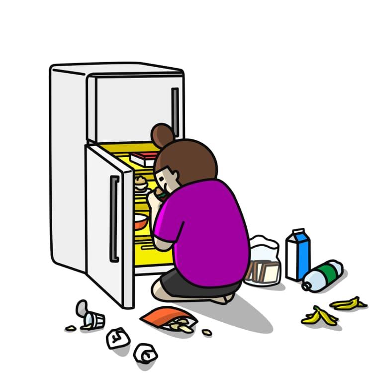 冷蔵庫の中をあさる女性